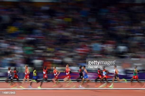 04 Mohamed Farah of Great Britain leads the pack as he competes in Men's 10000m Final on Day 8 of the London 2012 Olympic Games at Olympic Stadium on...