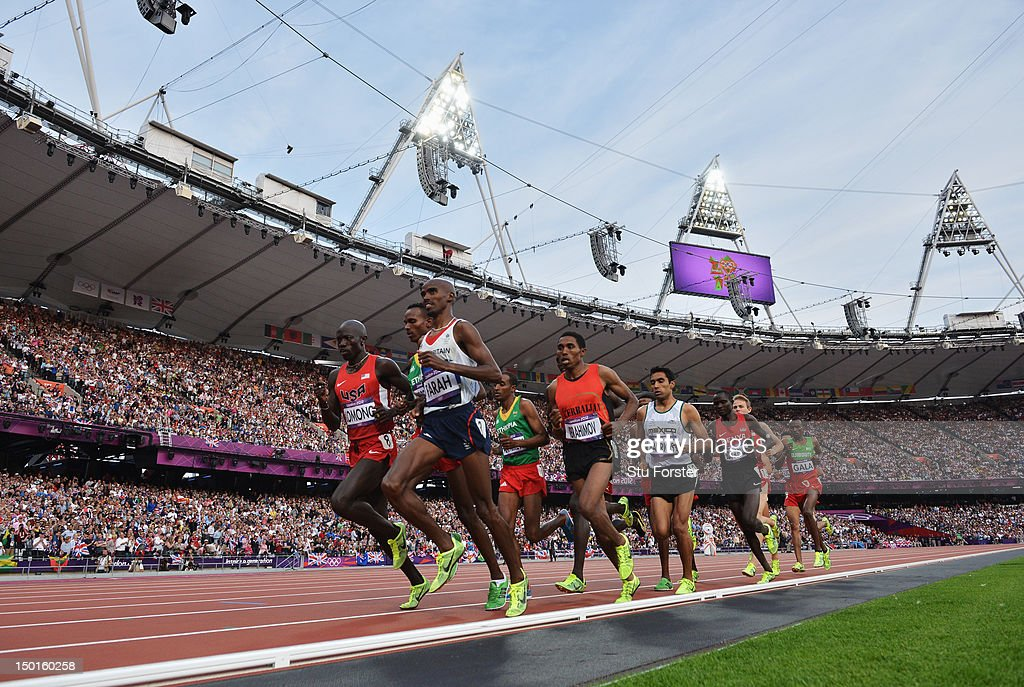 Mohamed Farah of Great Britain leads the pack as they compete in the Men's 5000m Final on Day 15 of the London 2012 Olympic Games at Olympic Stadium on August 11, 2012 in London, England.