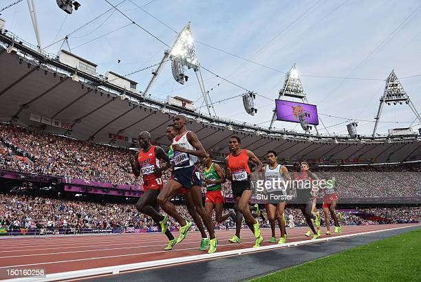 Mohamed Farah of Great Britain leads the pack as they compete in the Men's 5000m Final on Day 15 of the London 2012 Olympic Games at Olympic Stadium...