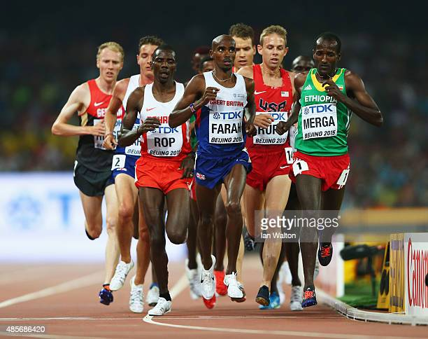Mohamed Farah of Great Britain leads the pack in the Men's 5000 metres final during day eight of the 15th IAAF World Athletics Championships Beijing...