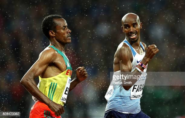 Mohamed Farah of Great Britain looks back towards Muktar Edris of Ethiopia as they compete in the Men's 5000 Metres heats during day six of the 16th...