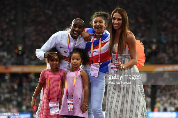 Mohamed Farah of Great Britain poses with his family on the podium after being presented with his silver medal after finishing second in the Men's...