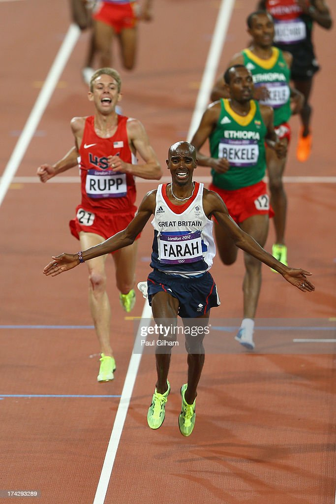 Mohamed Farah of Great Britain raises his arms as he crosses the line to win the Men's 10 000 metres final on Day 8 of the London 2012 Olympic Games at Olympic Stadium on August 4, 2012 in London, England.