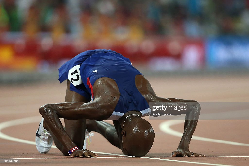 Mohamed Farah of Great Britain reacts after winning gold in the Men's 10000 metres final during day one of the 15th IAAF World Athletics Championships Beijing 2015 at Beijing National Stadium on August 22, 2015 in Beijing, China.