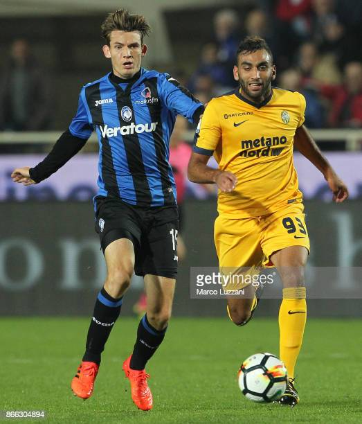 Mohamed Fares of Hellas Verona FC is challenged by Marten De Roon of Atalanta BC during the Serie A match between Atalanta BC and Hellas Verona FC at...