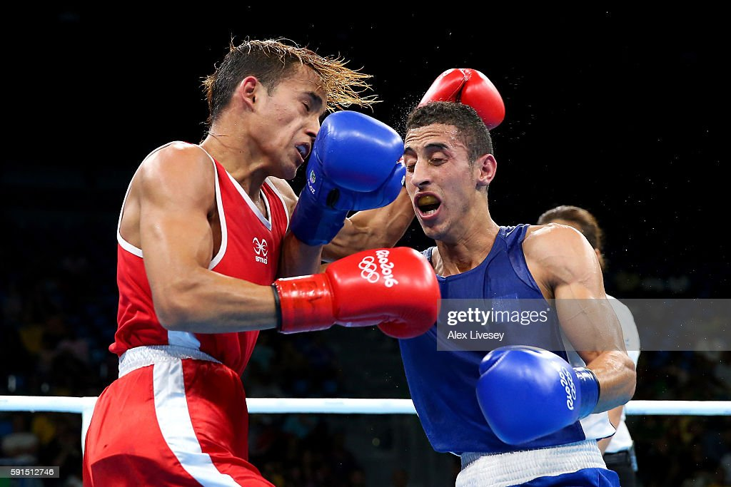 Mohamed Flisso of Algeria and Yoel Segundo Finol of Venezuela (red) exchange blows in the Men's Fly Quarterfinal bout during Day 12 of the Rio 2016 Olympic Games at Riocentro - Pavilion 6 on August 17, 2016 in Rio de Janeiro, Brazil.