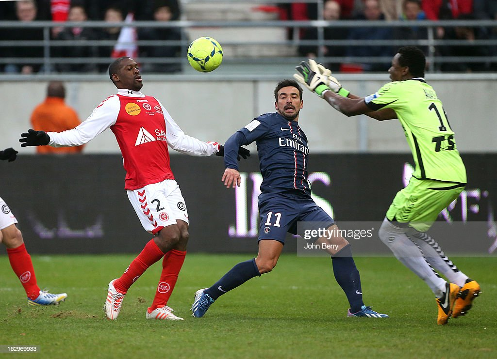 Mohamed Fofana of Reims, Ezequiel Lavezzi of PSG and Kossi Agassa, goalieeper of Reims in action during the french Ligue 1 match between Stade de Reims Champagne FC and Paris Saint-Germain FC at the Stade Auguste Delaune on March 2, 2013 in Reims, France.