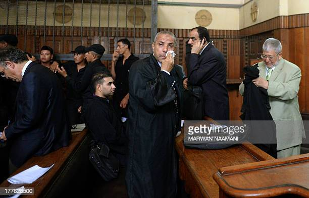 Mohamed Gharib and Atef alJalali two of the lawyers of Muslim Brotherhood supreme leader Mohamed Badie and 32 other Islamist defendants arrive for a...