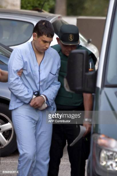 Mohamed Houli Chemlal suspected of involvement in the terror cell that carried out twin attacks in Spain is escorded by Spanish Civil Guards from a...