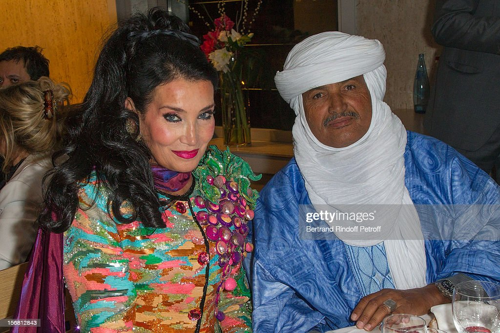 Mohamed Ixa (R), Tuareg nomad, Sahara guide, and President of the Niger-based non-profit organization, NGO Tidene and Les Puits du desert, and Lamia Khashoggi attend world-famous tenor and conductor Placido Domingo's induction ceremony as Goodwill Ambassador of UNESCO, at UNESCO on November 21, 2012 in Paris, France.
