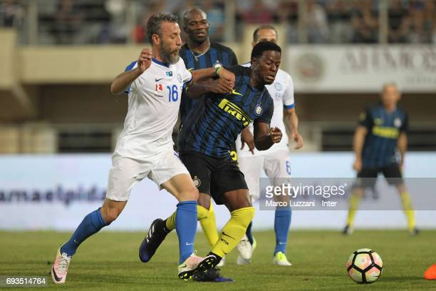 Mohamed Kallon of Inter Forever competes for the ball with Pantelis Kafes of Greece 2004 during the friendlt match between Greece 2004 and Inter...