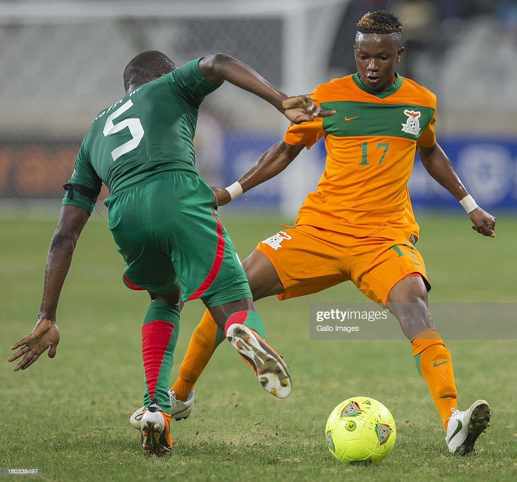 AFRICA - JANUARY 29, Mohamed Koffi from Burkina Faso (L) and Rainford Kalaba from Zambia during the 2013 Orange African Cup of Nations match between Burkina Faso and Zambia from Mbombela Stadium on January 29, 2013 in Nelspruit, South Africa.