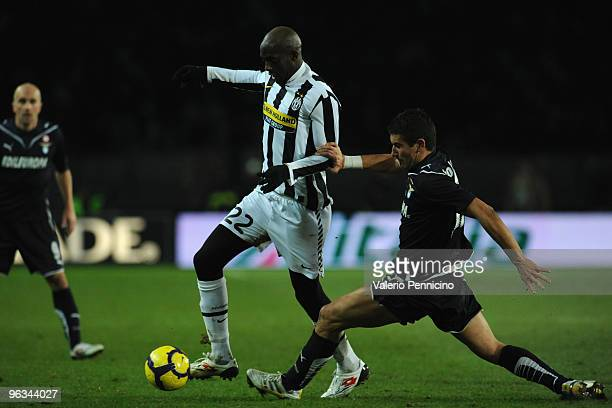 Mohamed Lamine Sissoko of Juventus FC battles for the ball with Aleksandar Kolarov of SS Lazio during the Serie A match between Juventus FC and SS...