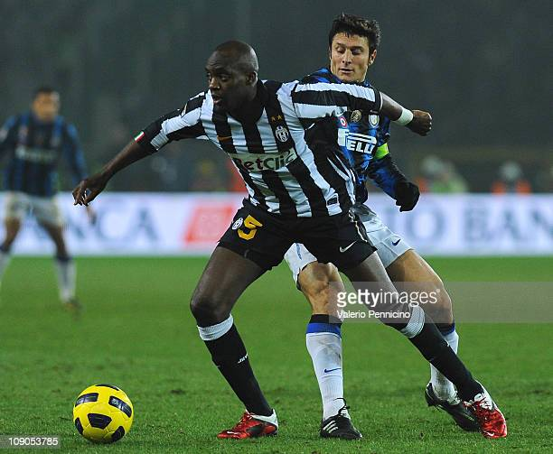 Mohamed Lamine Sissoko of Juventus FC is challenged by Javier Zanetti of FC Internazionale Milano during the Serie A match between Juventus FC and FC...