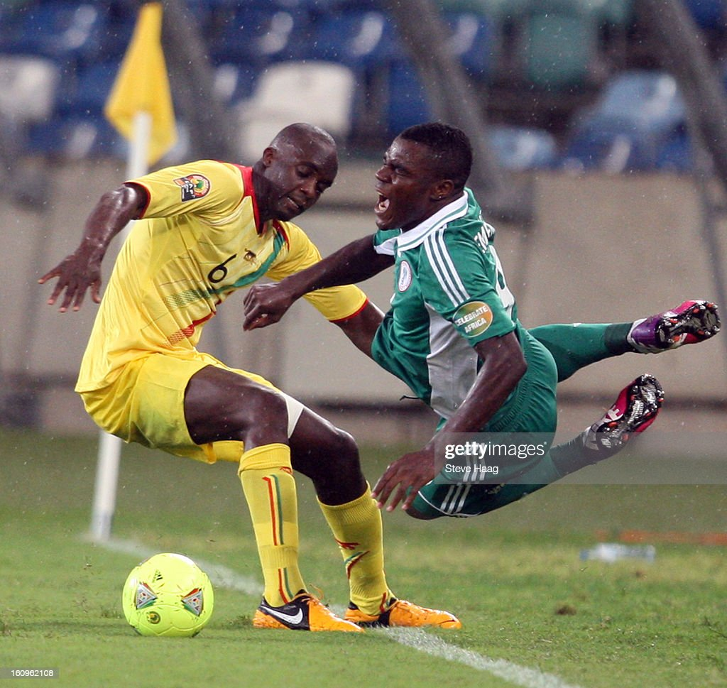 Mohamed Lamine Sissoko of Mali with a bad tackle on Emmanuel Emenike of Nigeria during the 2013 African Cup of Nations Semi-Final match between Mali and Nigeria at Moses Mahbida Stadium on February 06, 2013 in Durban, South Africa.