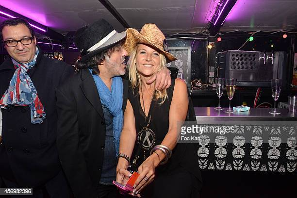 Mohamed Mestar Rachid Taha and a guest attend the James Arch Party At The River's King boat on october 9 2014 in Paris France