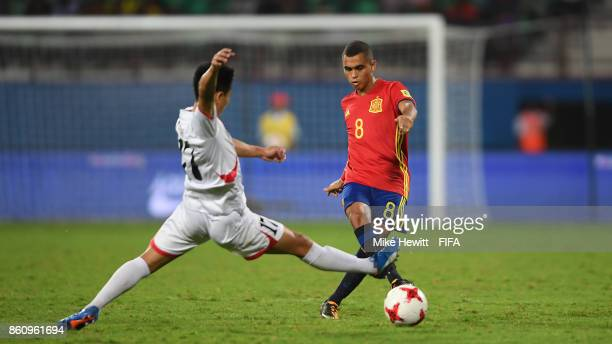 Mohamed Moukhliss of Spain is challenged by Yun Min of Korea DPR during the FIFA U17 World Cup India 2017 group D match between Spain and Korea DPR...