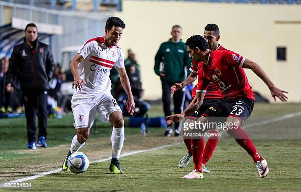 Mohamed Naguib of Al Ahly in action against Mohamed Ibrahim of Zamalek during the Egypt Premier League match between Al Ahly and Zamalek at the Petro...