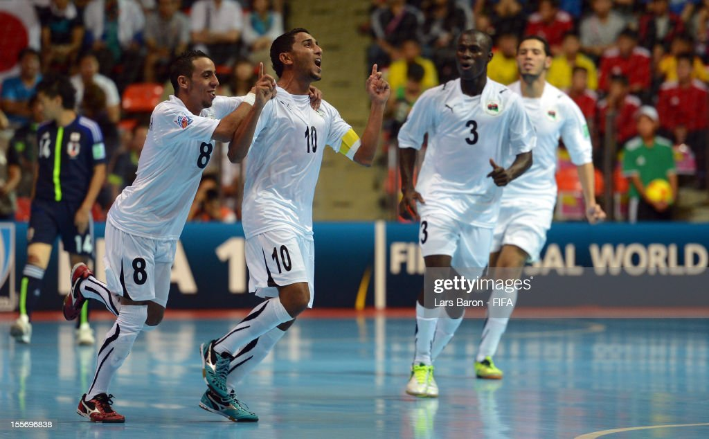 Mohamed Rahoma of Libya celebrates after scoring his teams first goal during the FIFA Futsal World Cup Group C match between Japan and Libya at Indoor Stadium Huamark on November 7, 2012 in Bangkok, Thailand.