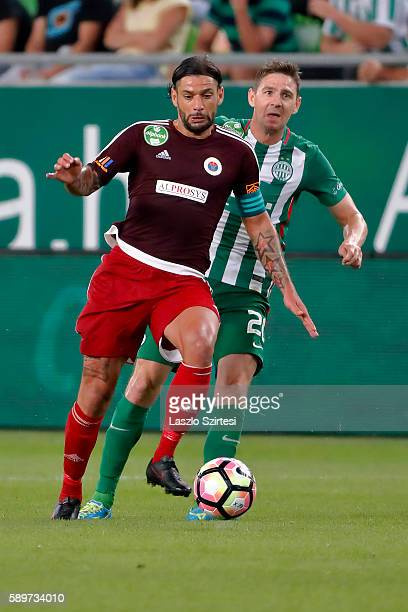 Mohamed Remili of Vasas FC leaves Zoltan Gera of Ferencvarosi TC behind during the Hungarian OTP Bank Liga match between Ferencvarosi TC and Vasas FC...