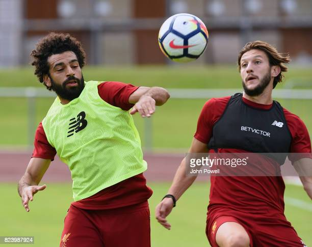 Mohamed Salah and Adam Lallana of Liverpool during a training session at RottachEgern on July 28 2017 in Munich Germany