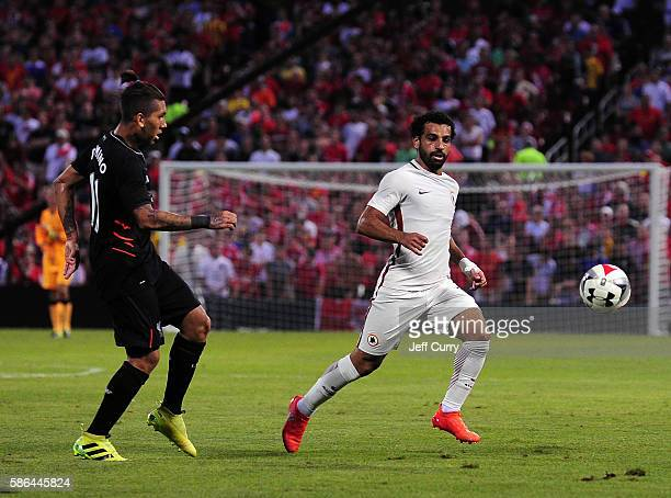 Mohamed Salah of AS Roma and Roberto Firmino of Liverpool FC chase the ball during a friendly match at Busch Stadium on August 1 2016 in St Louis...