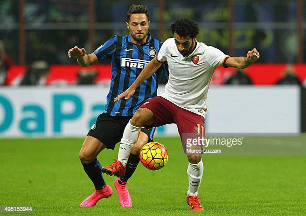 Mohamed Salah of AS Roma competes for the ball with Danilo D Ambrosio of FC Internazionale Milano during the Serie A match between FC Internazionale...