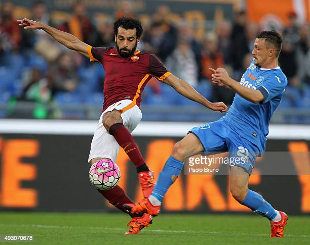 Mohamed Salah of AS Roma competes for the ball with Mario Rui of Empoli FC during the Serie A match between AS Roma and Empoli FC at Stadio Olimpico...