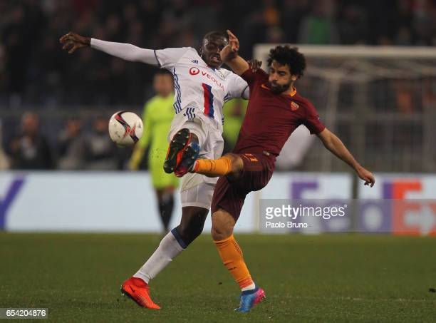 Mohamed Salah of AS Roma competes for the ball with Mouctar Diakhaby of Olympique Lyonnais during the UEFA Europa League Round of 16 second leg match...