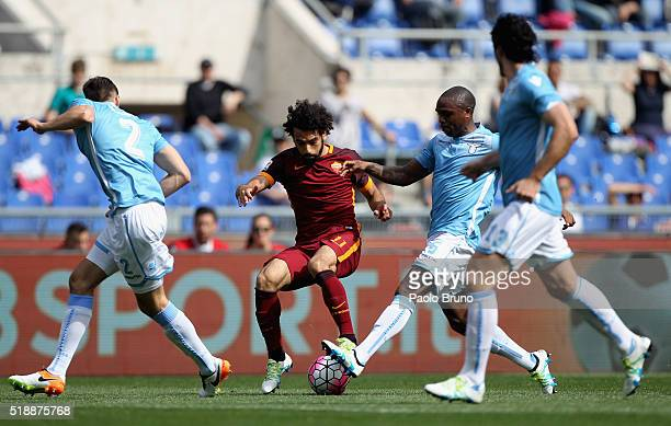 Mohamed Salah of AS Roma competes for the ball with SS Lazio players during the Serie A match between SS Lazio and AS Roma at Stadio Olimpico on...