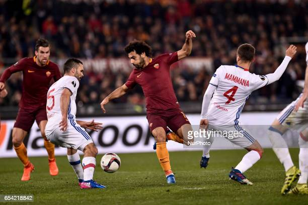 Mohamed Salah of AS Roma is challenged by Emanuel Mammana of Olympique Lyonnais during the UEFA Europa League match between Roma and Olympique...