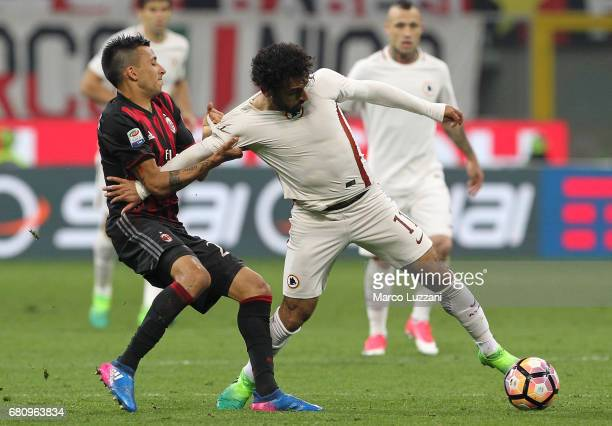 Mohamed Salah of AS Roma is pulled by his shirt by Leonel Vangioni of AC Milan during the Serie A match between AC Milan and AS Roma at Stadio...