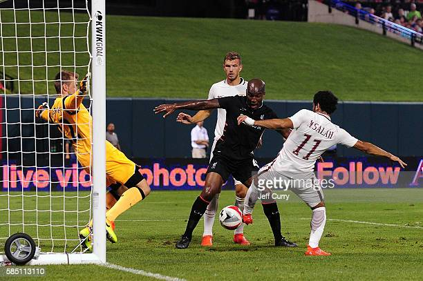 Mohamed Salah of AS Roma scores the game winning goal against Simon Mignolet of Liverpool FC during a friendly match at Busch Stadium on August 1...