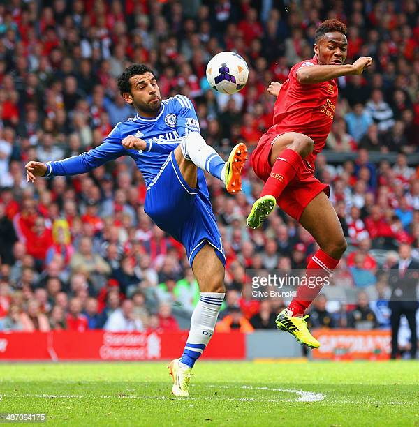 Mohamed Salah of Chelsea and Raheem Sterling of Liverpool battle for the ball during the Barclays Premier League match between Liverpool and Chelsea...