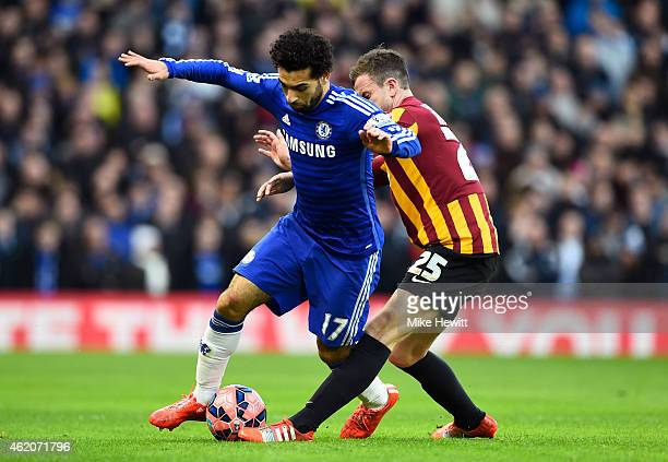 Mohamed Salah of Chelsea is tackled by Andrew Halliday of Bradford City during the FA Cup Fourth Round match between Chelsea and Bradford City at...