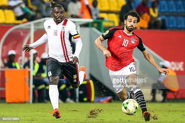 Mohamed Salah of Egypt in action against Hassan Wasswa of Uganda during the African Cup of Nations 2017 Group D football match between Egypt and...