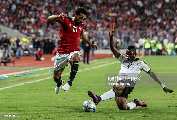Mohamed Salah of Egypt in action against Wakaso Mubarak of Ghana during the 2018 World Cup Africa qualifying match between Egypt and Ghana at the...