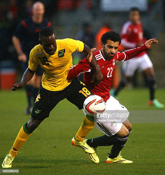 Mohamed Salah of Egypt looks to hold off Jamacia's Simon Dawkins during the International Friendly match between Jamacia and Egypt at The Matchroom...