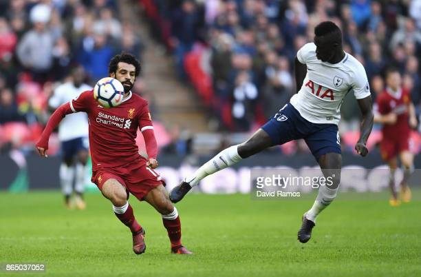 Mohamed Salah of Liverpool and Davinson Sanchez of Tottenham Hotspur battle for possession during the Premier League match between Tottenham Hotspur...