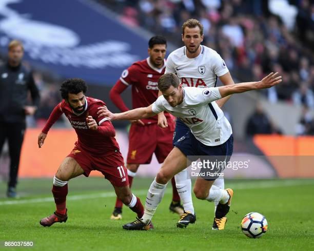 Mohamed Salah of Liverpool and Jan Vertonghen of Tottenham Hotspur battle for possession during the Premier League match between Tottenham Hotspur...