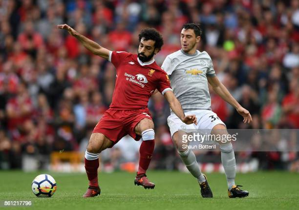 Mohamed Salah of Liverpool and Matteo Darmian of Manchester United battle for possession during the Premier League match between Liverpool and...