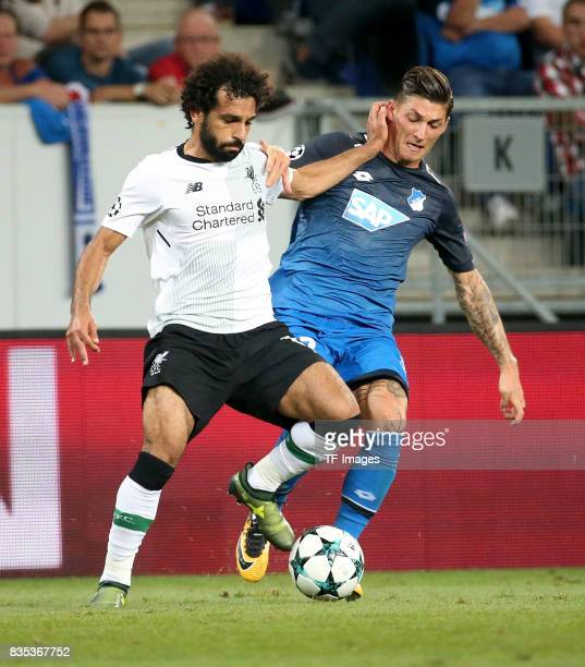 Mohamed Salah of Liverpool and Steven Zuber of Hoffenheim battle for the ball during the UEFA Champions League Qualifying PlayOffs Round First Leg...