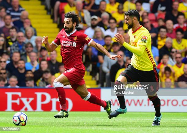 Mohamed Salah of Liverpool attempts to take the ball past Miguel Britos of Watford during the Premier League match between Watford and Liverpool at...