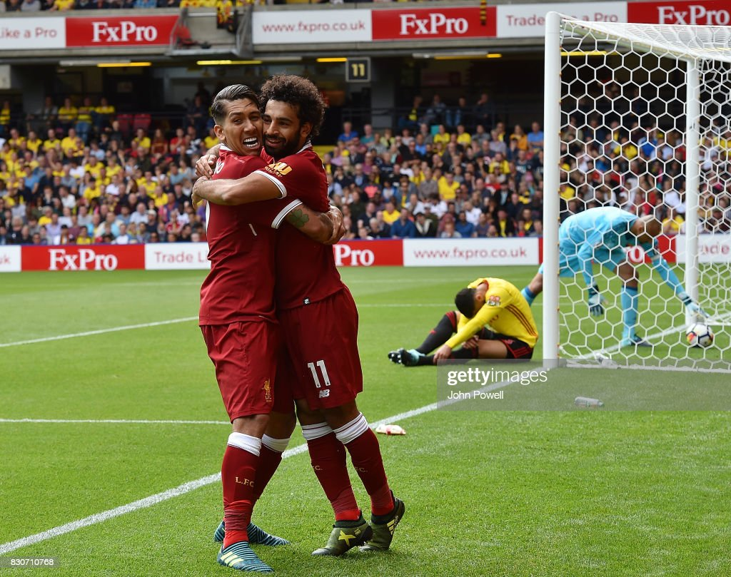 Mohamed Salah of Liverpool celebrates after scoring during the Premier League match between Watford and Liverpool at Vicarage Road on August 12, 2017 in Watford, England.