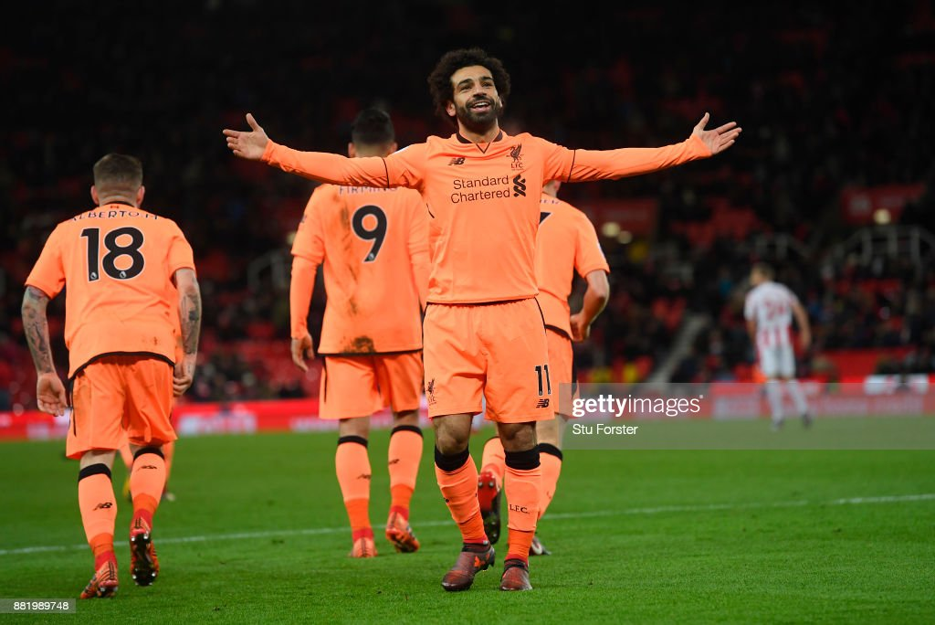 Mohamed Salah of Liverpool celebrates after scoring his sides third goal during the Premier League match between Stoke City and Liverpool at Bet365 Stadium on November 29, 2017 in Stoke on Trent, England.