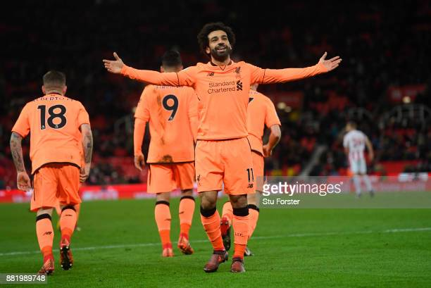 Mohamed Salah of Liverpool celebrates after scoring his sides third goal during the Premier League match between Stoke City and Liverpool at Bet365...