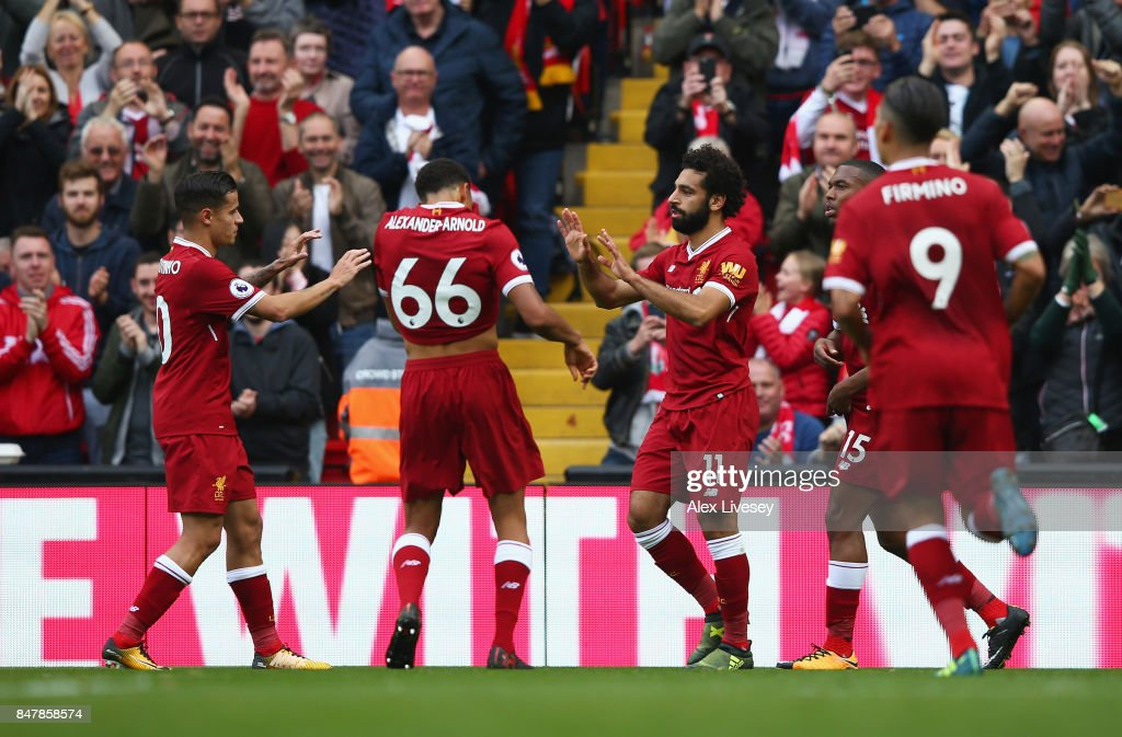Mohamed Salah of Liverpool celebrates scoring his sides first goal with his Liverpool team mates during the Premier League match between Liverpool and Burnley at Anfield on September 16, 2017 in Liverpool, England.