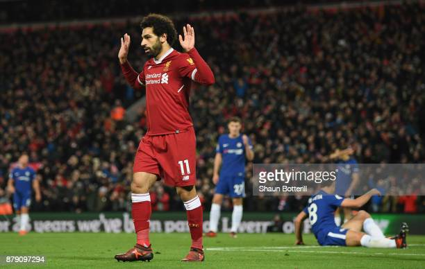 Mohamed Salah of Liverpool celebrates scoring his sides first goal during the Premier League match between Liverpool and Chelsea at Anfield on...