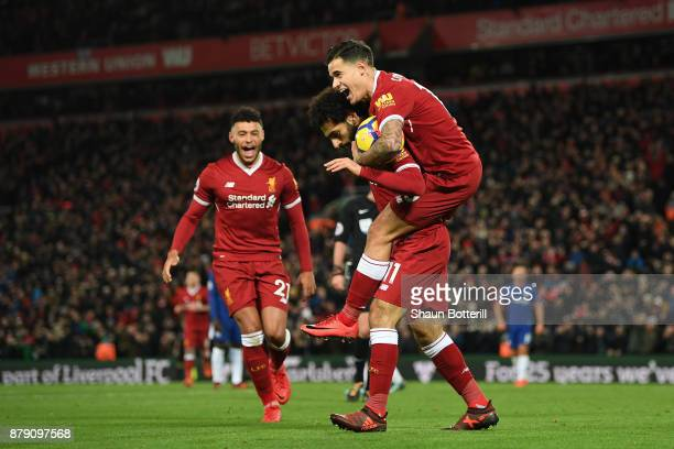 Mohamed Salah of Liverpool celebrates scoring his sides first goal with Philippe Coutinho of Liverpool during the Premier League match between...