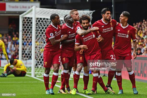 Mohamed Salah of Liverpool celebrates scoring his sides third goal with his Liverpool team mates during the Premier League match between Watford and...
